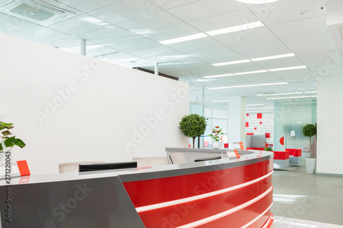fototapeta na lodówkę Minsk, Belarus - May 23, 2019: Reception area for visitors of modern office with red-white interior