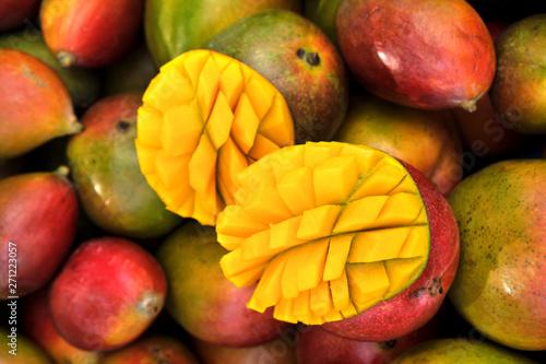 Fotografia, Obraz  Close up fresh mango fruit on market stall in southern Spain