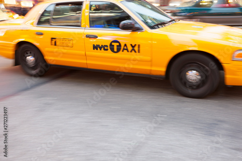 Foto auf Leinwand New York TAXI Panning image of a Yellow Taxi cab in Times Square, New York City. New York. USA