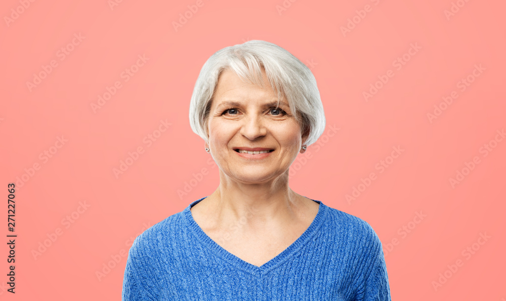 Fototapety, obrazy: old people concept - portrait of smiling senior woman in blue sweater over pink or living coral background