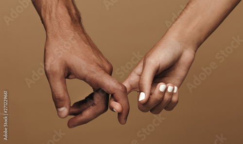 Couple linking index fingers Wallpaper Mural