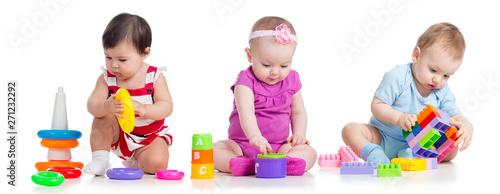 Obraz na płótnie nursery babies with educational toys, isolated on white