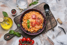 Plate With Tasty Risotto On Grey Background