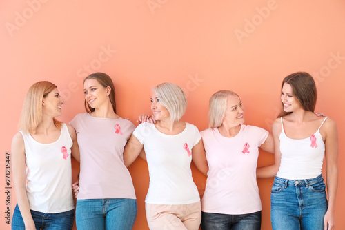 Fotografie, Obraz  Beautiful women of different ages with pink ribbons on color background