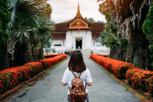 Young Woman Traveler With Backpack Traveling Into The National Museum In Old Town District Luang Prabang Province, Laos