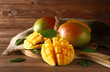 canvas print picture - Board with tasty fresh mango on wooden table
