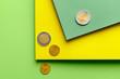 Leinwandbild Motiv Paper sheets with coins on color background