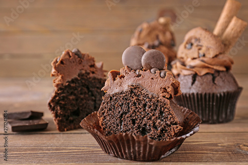 Tasty chocolate cupcake on wooden background Canvas Print