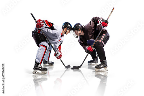 Canvas Print Hockey player isolated in white background starts game