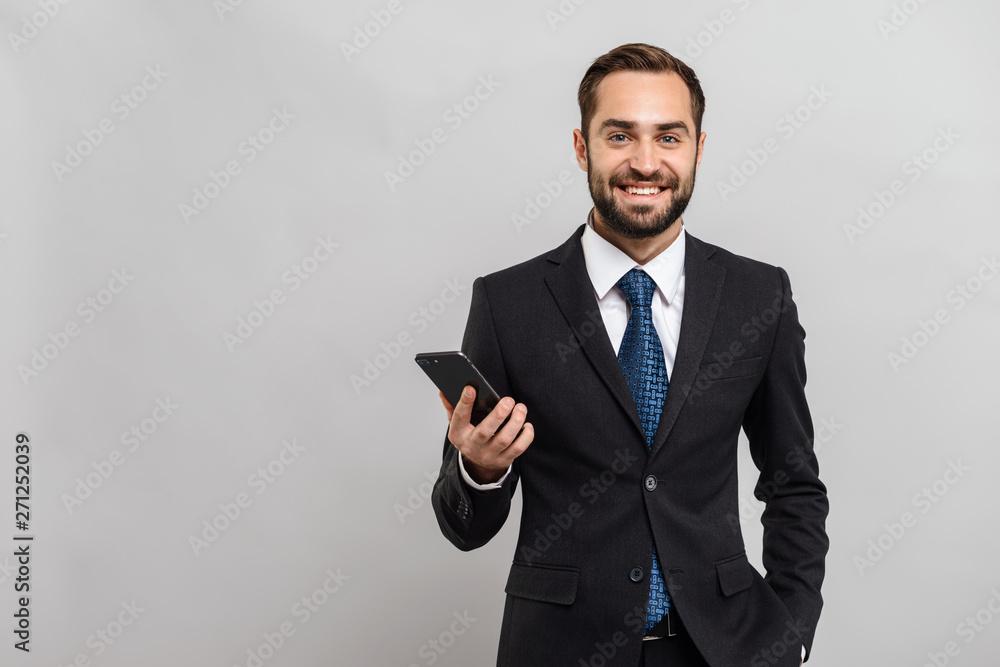 Fototapeta Attractive young businessman wearing suit