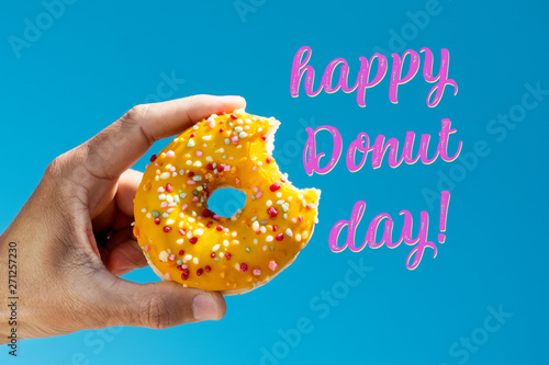 nibbled donut and text happy donut day