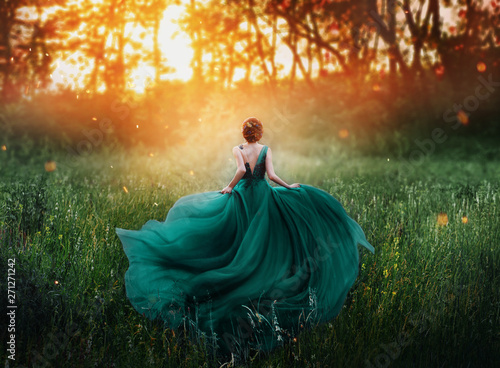 Fényképezés magical picture, girl with red hair runs into dark mysterious forest, lady in lo