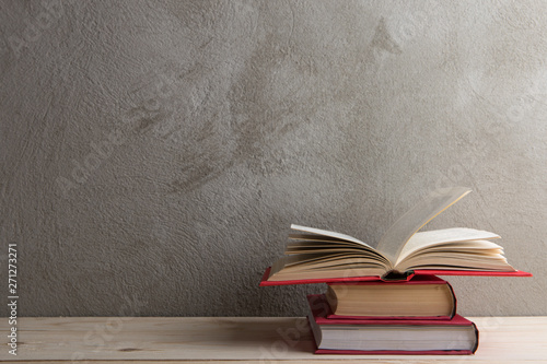 Fotografering  Education and reading concept - group of colorful books on the wooden table, con