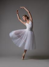 Ballerina Dancing In White Dress. Color Photo.