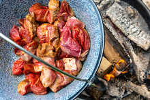 Frying The Raw Beef In A Cauldron Over An Open Wood Fire To Prepare The Hungarian Cauldron Goulash, Food