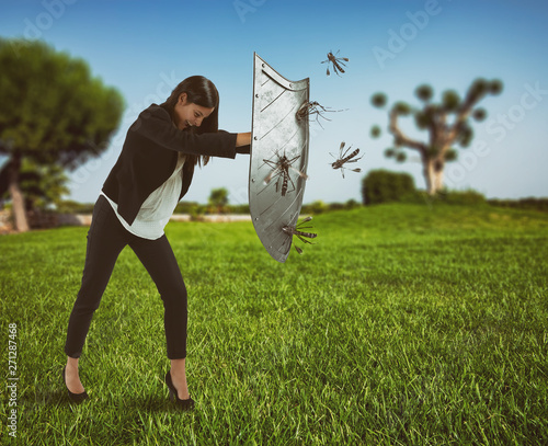 Woman defends herself from the attack of mosquitoes with a shield Wall mural