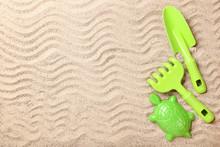 Plastic Toys On Beach Sand