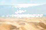 Summer tropical sand beach and bokeh sun light on sea background, copy space.