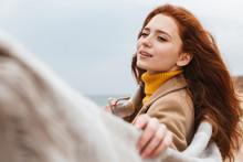 Beautiful Young Redheaded Woman Wearing Coat