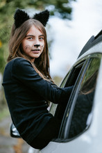 Girl In A Cat's Costume At Halloween