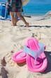 Leinwandbild Motiv sandals in the sand of the beach