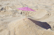 Leinwandbild Motiv parasol in the sand of the beach