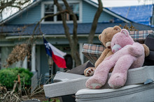 One Week After Hurricane Harvey In Front Of Destroyed Home Two Teddy Bears Hold Each Other