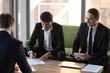 Leinwandbild Motiv Businessmen sign business contract after successful negotiations