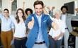 Leinwanddruck Bild - Happy business people celebrating success at company.