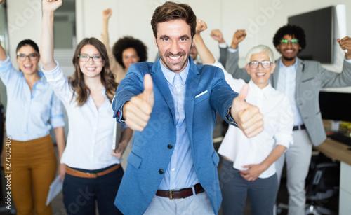 Fototapeta Happy business people celebrating success at company. obraz