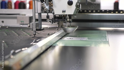 Fotografie, Obraz  Robotics works in tailoring production line