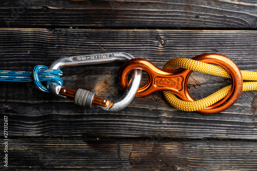 Obraz Close up of climbing gear on wooden desk - table top shot - fototapety do salonu