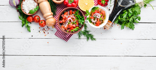 Canvas Prints Hot chili peppers salsa sauce and ingredients. Latin American Mexican Traditional Sauce. Top view. On a white wooden background. Free space for text.