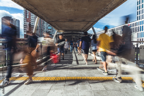 Tablou Canvas Motion blur of crowded Asian people walking on elevated public walkway