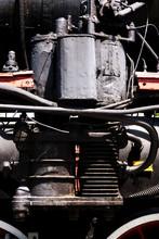 Old Black Ribbed Steam Mechanical Cylinder.