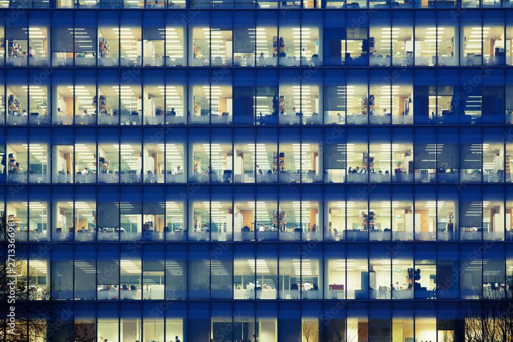 Fototapeta Modern office building at dusk