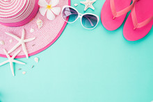 Top View Of Beach Accessories Flip Flop, Starfish Beach Hat And Sea Shell On Bright Pastel Green Background For Summer Holiday And Vacation Concept. Flat Lay.