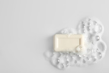 Soap Bar And Foam On White Background, Top View. Mockup For Design