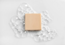 Soap Bar And Foam On White Bac...