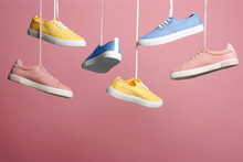 Bright Stylish Shoes Hanging A...