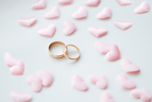 Wedding Rings On A White Background In Pink Hearts