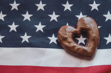 Heart Shaped Biscuits And Usa Flag On Wooden Table Happy Memorial Day.