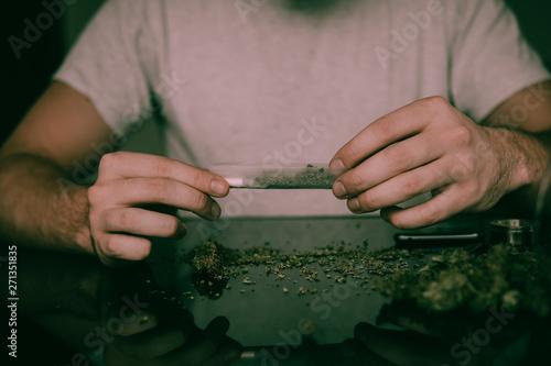 Photo  Close up of addict lighting up marijuana joint with lighter