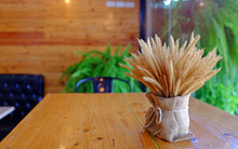 Beautiful Dry Grass Flowers Decorated With Vintage Style On The Wood Table On Cafe.
