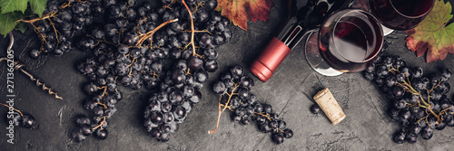 Wine composition on dark rustic background, flat lay
