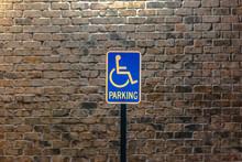 Handicap Parking Sign Against ...