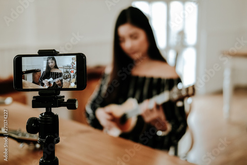 blogger live broadcasting music instrument tutorial on social media. vlogger recording online vlog video. - 271374227