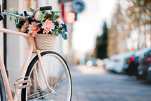 White Bicycle With Basket Of F...