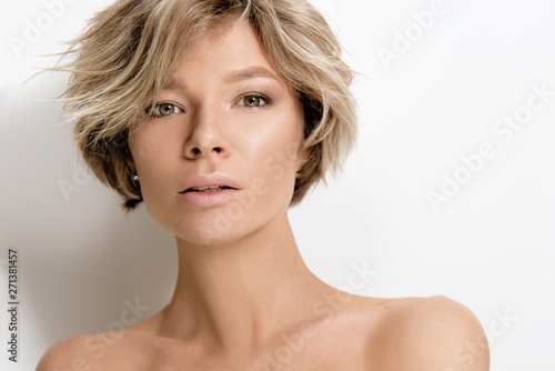 Valokuvatapetti Beautiful young woman model with light color hair