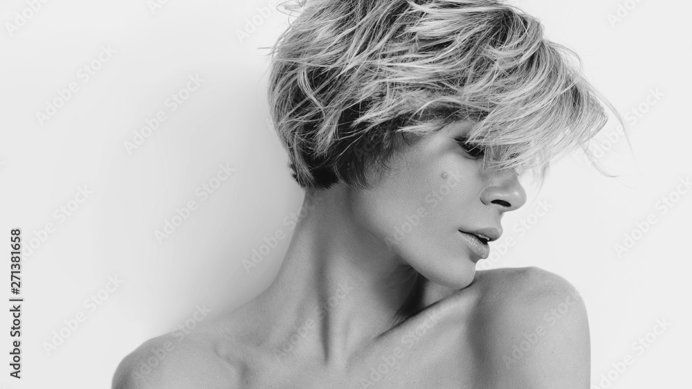 Fototapety, obrazy: Beautiful young woman model with light color hair. Beauty portrait with clean skin and nude makeup. Natural beauty. Haircare, make-up. Studio black and white portrait